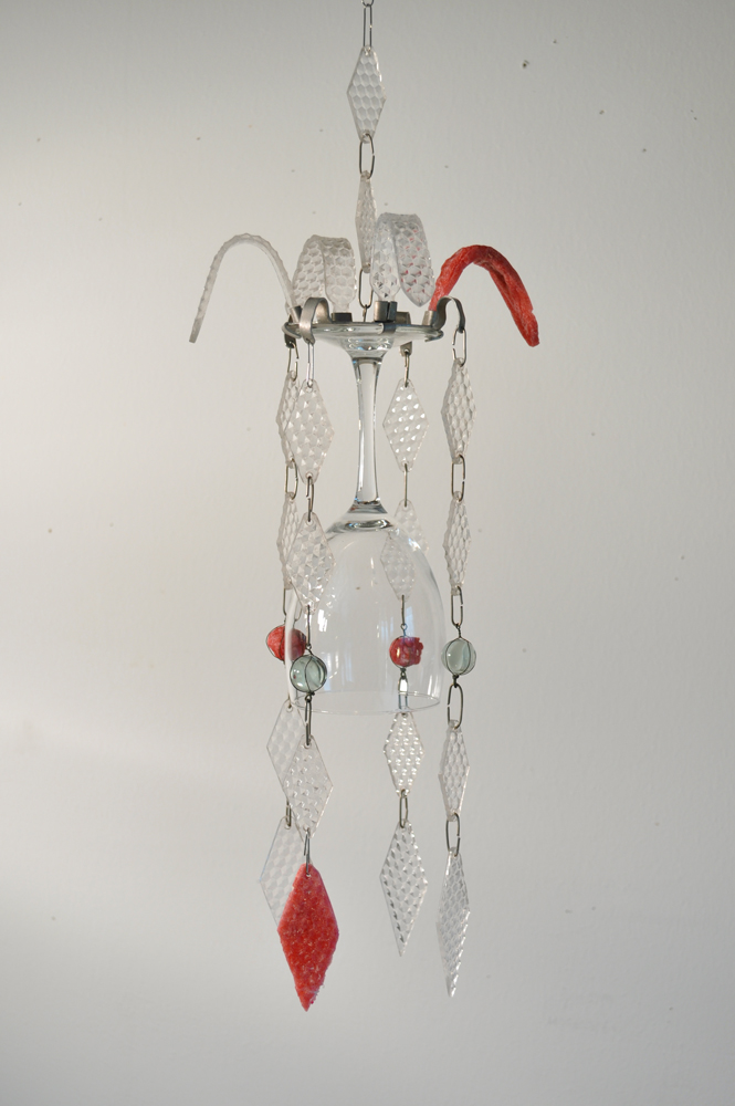Horizon. Wind chime hanging fixed with red napalm b. Glass, aluminum, iron, clear acrylic, red napalm b. 2013