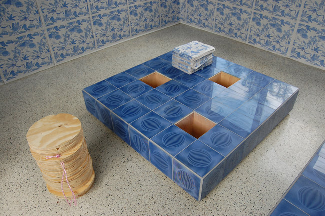 "Gean Moreno and Ernesto Oroza. Untitled (decoy), 2010. Wood and found tiles. Functional object 48"" x 48"" x 12"""